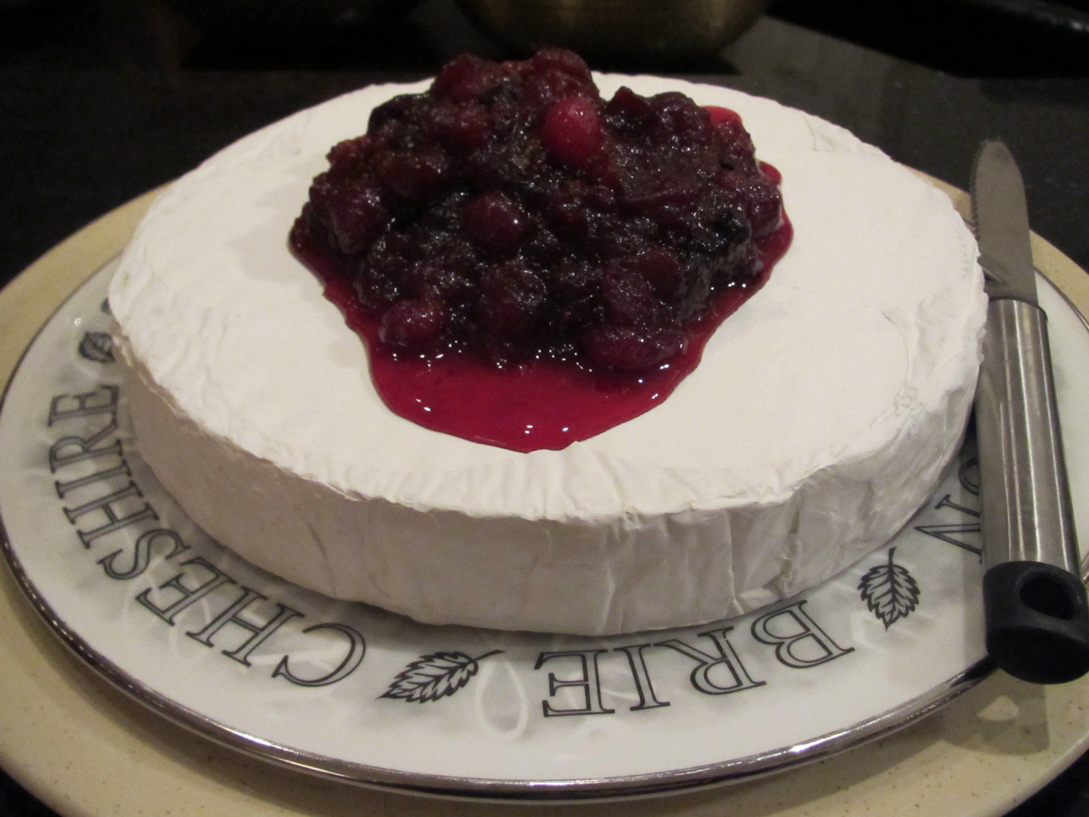 Cranberry Ginger Holiday Brie Recipe - perfect for Christmas or a New Year's Eve celebration!