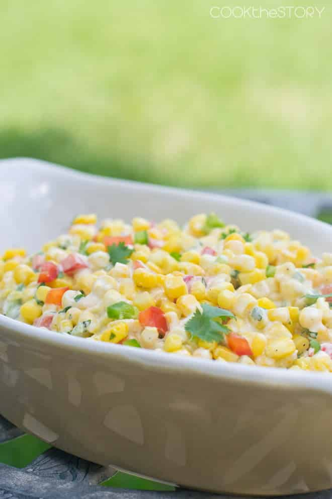 This summer corn salad recipe is sweet, creamy and spicy all at once. Perfect for your summer BBQs!
