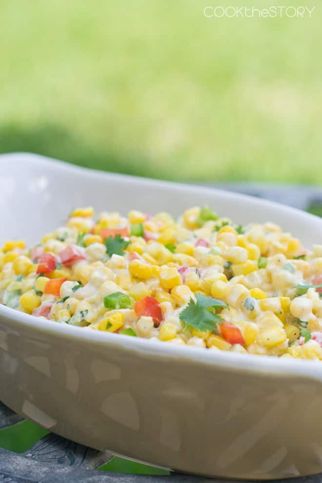 Creamy Corn Salad in a white serving bowl.