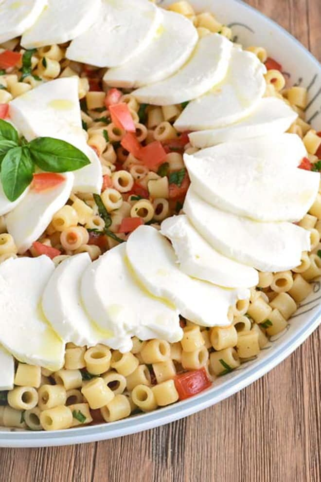 This make-ahead Caprese pasta salad recipe is filled with fresh mozzarella, tomato, basil, and perfectly al dente pasta. It's the perfect thing to serve on a warm day.