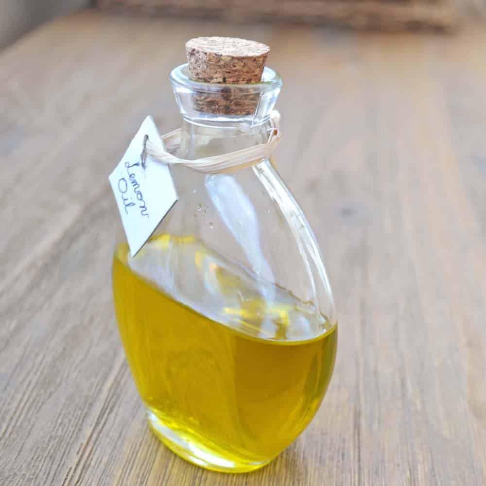 Lemon oil in corked glass jar.