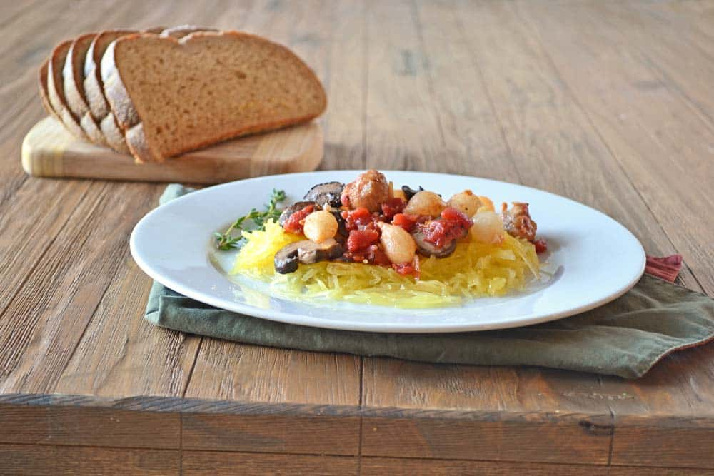 One of my favorite quick meals: Spaghetti Squash with Vegetables over Spaghetti Squash - get the recipe at COOKtheSTORY.com