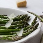 A delicious appetizer made of quick-roasted asparagus, Parmesan cheese, olive oil, salt and pepper. Simple flavors have never been so good!