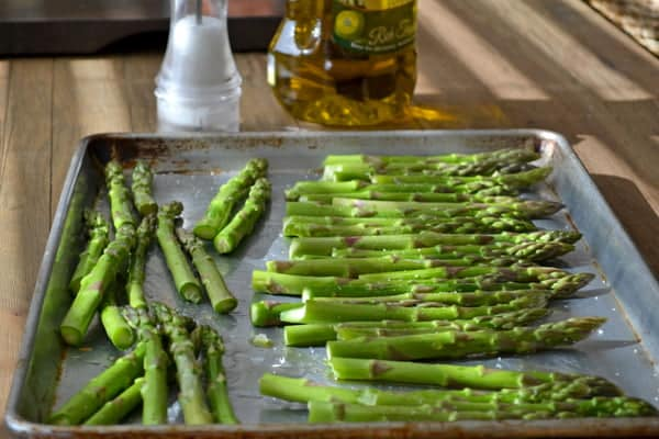 Asparagus getting ready for the oven where they will be roasted and then turned into a delicious but easy appetizer with parmesan cheese