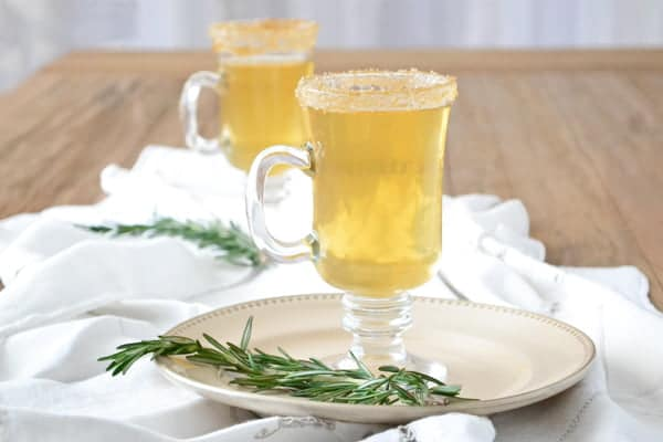 Easy Hot Apple Cider Recipe, jazzed up with rosemary and whiskey for the grown-ups!