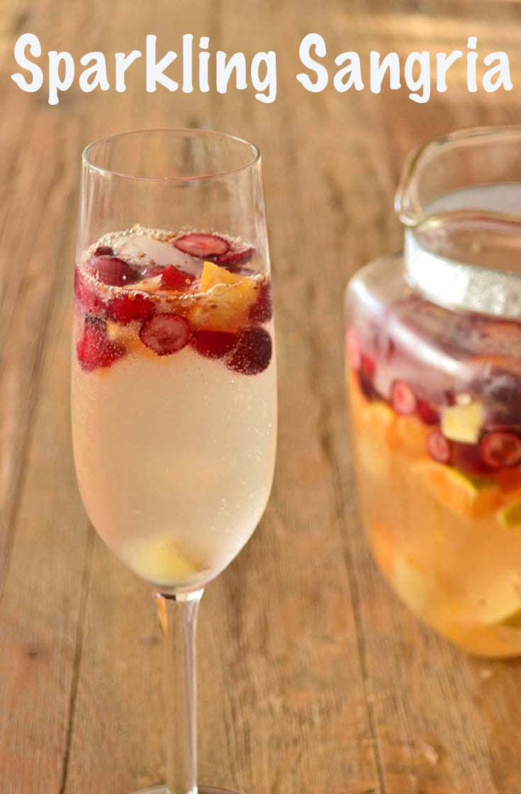 Make your New Year's Party sparkle with champagne cocktails like this Sparkling Sangria, made with champagne, oranges, and cranberries. #champagne #cocktail #sangria