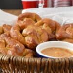 These are soft pretzels with a homemade mustard and strawberry dipping sauce.