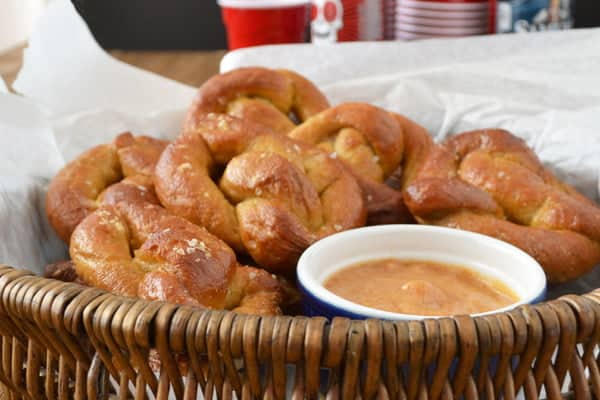 Find out how to make soft pretzels. Here is a basket of soft pretzels with a mustard strawberry dipping sauce.