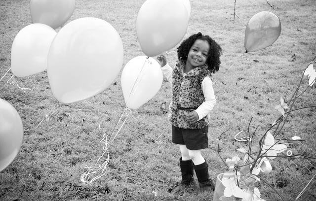 Using balloons in a child's photo shoot is both fun and sophisticated.