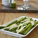 This is an asparagus appetizer with paremsan cheese. An example of a healthy appetizer that you can make when entertaining.