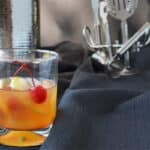 This is an apple cocktail that's a riff on an Old Fashioned, but it's made with apple liqueur. Get the recipe on COOKtheSTORY.com