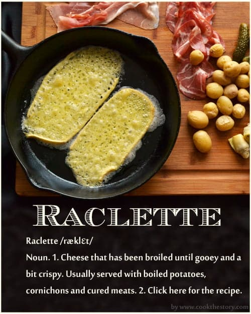 This is an image of raclette, a dish of swiss cheese melted and served with boiled potatoes, cured meats and cornichons. This version of raclette is broiled at home.