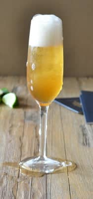 Bubbly Maple Leaf champagne cocktail - it has sparkling wine, scotch, maple syrup and lime juice. By www.cookthestory.com