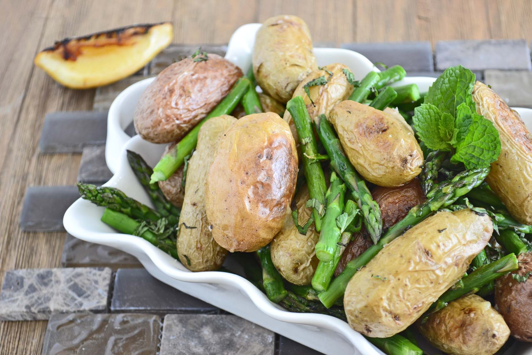 Romantic Dinner Tip #5: Go on a culinary adventure by deciding together to try something new, like the combination of mint and asparagus in this recipe for Roasted Potatoes and Asparagus with MInt and Charred Lemon by www.cookthestory.com