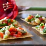 Healthy appetizer recipes like these crispy Asian wonton bites are a big hit at holiday parties. Get the recipe from COOKtheSTORY.com