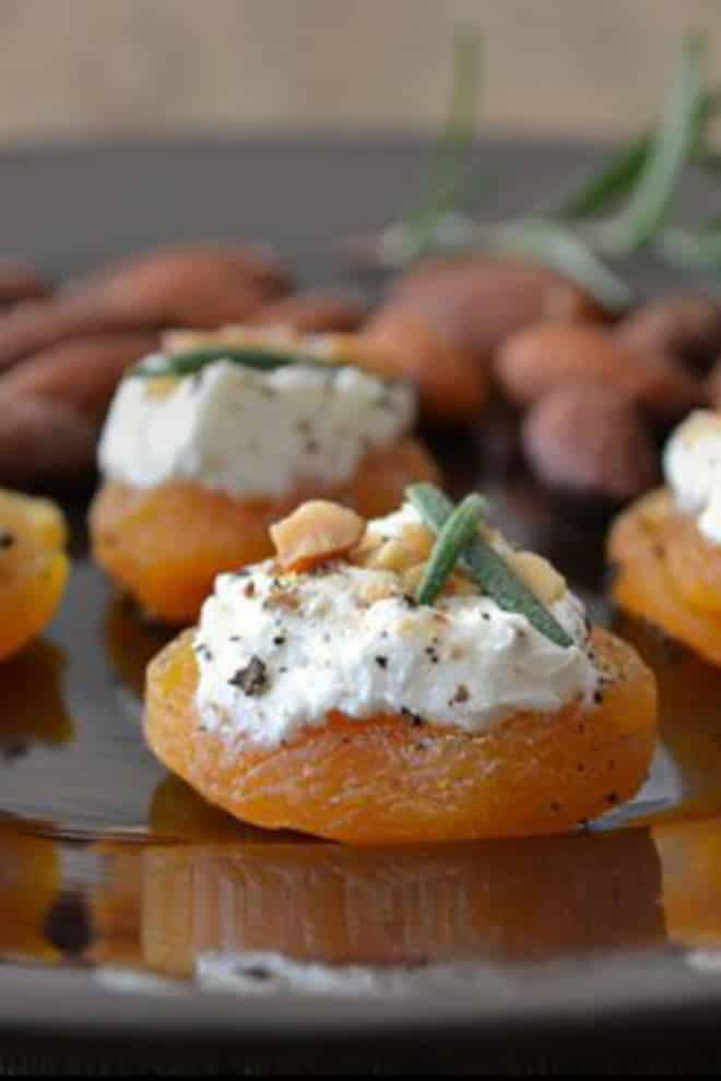 These little morsels are the perfect easy appetizers to keep you eating and having fun with your company without worrying about over-indulgence. Today's recipe is for Apricot Canapés with Goat Cheese, Almonds and Rosemary.