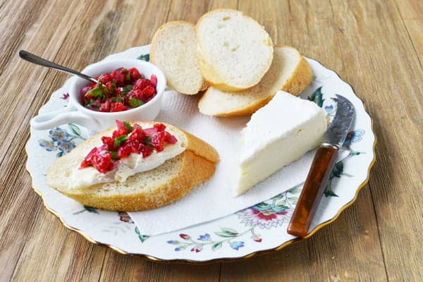 This Ploughman's Lunch is made with Brie and is served with a Raspberry Salsa. Recipe by Christine Pittman of www.cookthestory.com