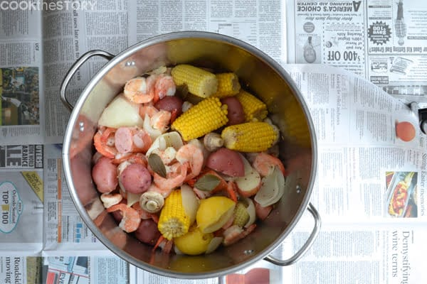 A unique shrimp boil recipe with mushrooms, dill and lots of soft garlic to squeeze on as a condiment. Click here for the delicious recipe by @cookthestory
