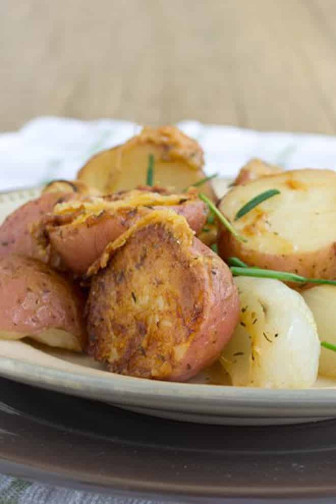 This is the best, roasted potato recipe because it's got browned red potatoes, crunchy Parmesan cheese, melty Parmesan cheese, and sweet sweet roasted Vidalia onions.