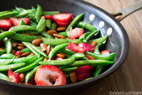Sautéed Strawberry Salad with Sugarsnap Peas, ALmonds and Fat-Free Balsamic Dressing. Get more easy healthy recipes at www.cookthestory.com