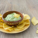 A Guacamole Recipe with Edamame instead of avocadoes! This Mexican Edamame Dip is lower fat and more protein than guacamole and is perfect for avocado-haters.