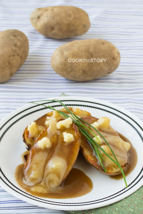Lazy Poutine made with baked potatoes, cheese and bottle gravy. A total craving buster by www.cookthestory.com