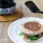 An easy burger recipe made using the Hamilton Beach Breakfast Sandwich Maker at www.cookthestory.com