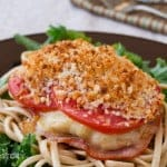 A Chicken Cordon Bleu recipe where the ingredients are stacked on top of the chicken instead of stuffed inside.