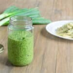 A pesto recipe made with onion tops, parsley and walnuts by @cookthestory