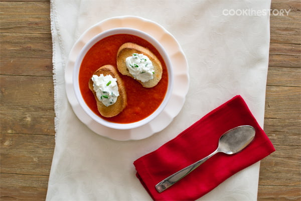 For this slow cooker soup, bell peppers are roasted in the slow cooker before being puréed with tomatoes. The goat cheese toasts float on top of the soup.