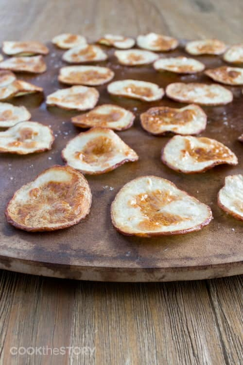 homemade potato chips on a pizza stone