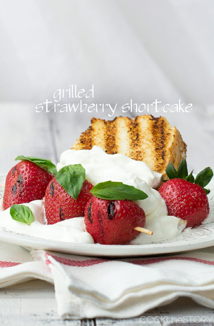 For this easy take on Strawberry Shortcake, you grill store-bought angel food cake & strawberries. Top with a puff of lemon and basil whipped cream. The easy hack of using store-bought angel food cake saves time for this simple dessert perfect for summer. #strawberry #cake #angelcake #grill #grilleddessert