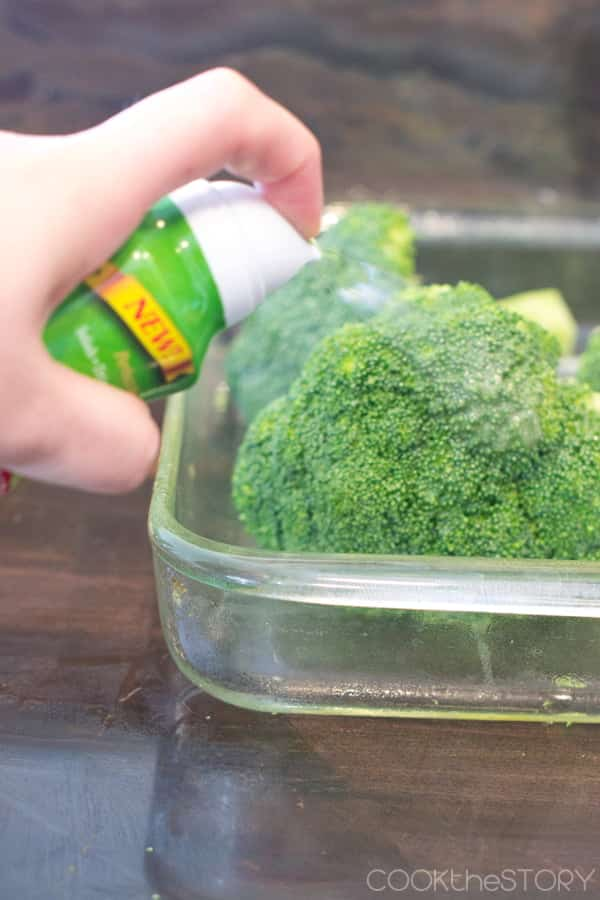 Spray the broccoli with olive oil.