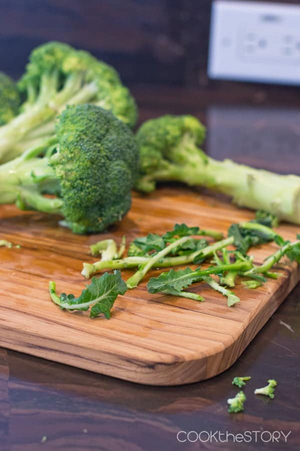 To peel broccoli stems, first pull off the leaves.