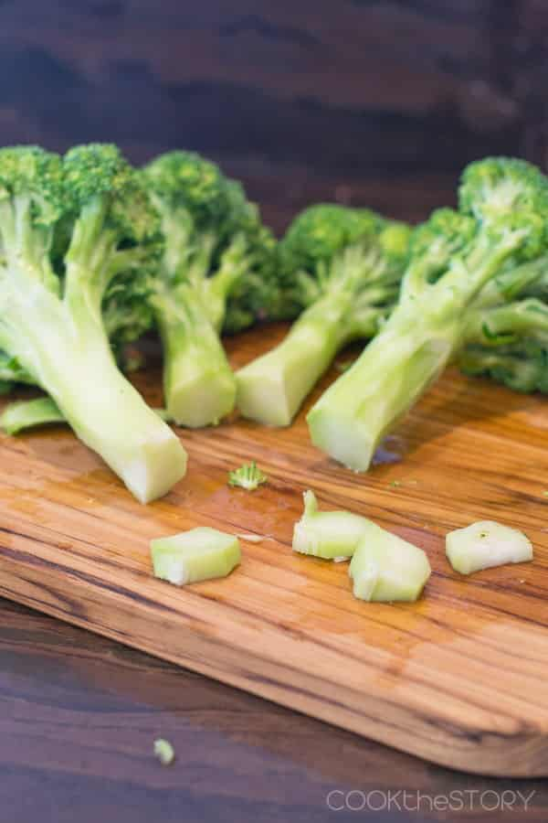 After peeling the broccoli, trim off the bottoms of the stalks.