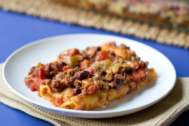 This Chili Enchiladas recipe is a cross of chili and enchiladas. You can use homemade chili, leftovers, or even store bought. Kids love this easy dinner!