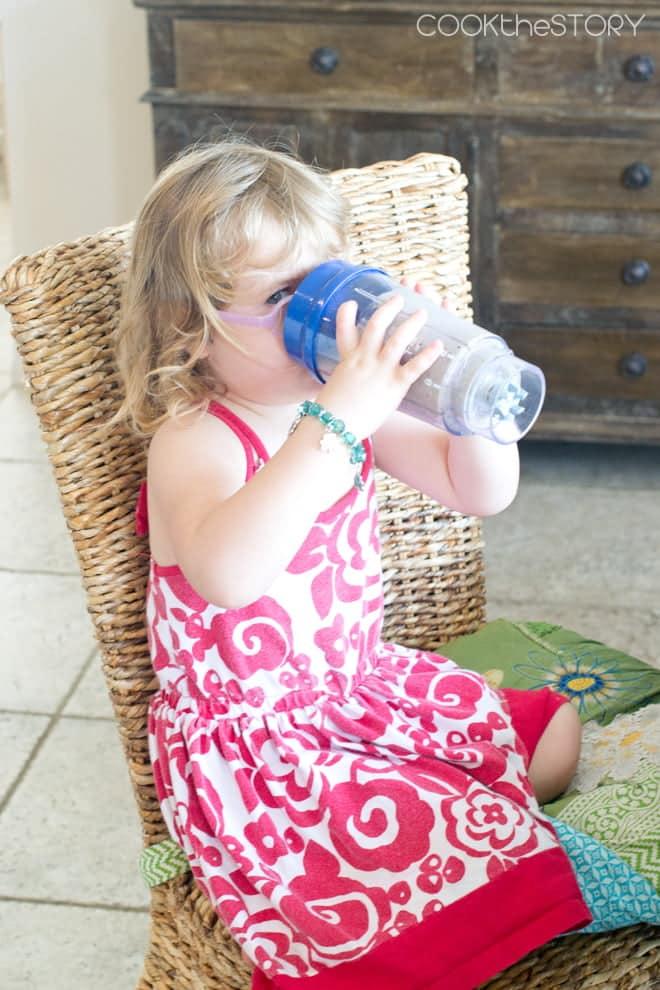Girl Drinking Blueberry Pancake Green Smoothie