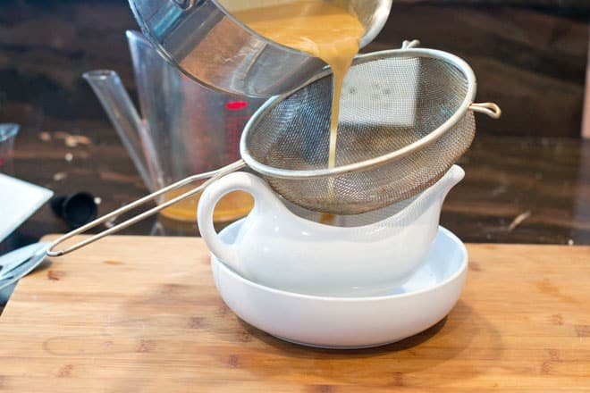 Strain the gravy using a fine mesh sieve