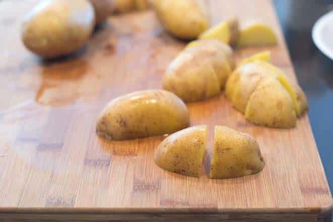 Cutting potatoes into chunks.