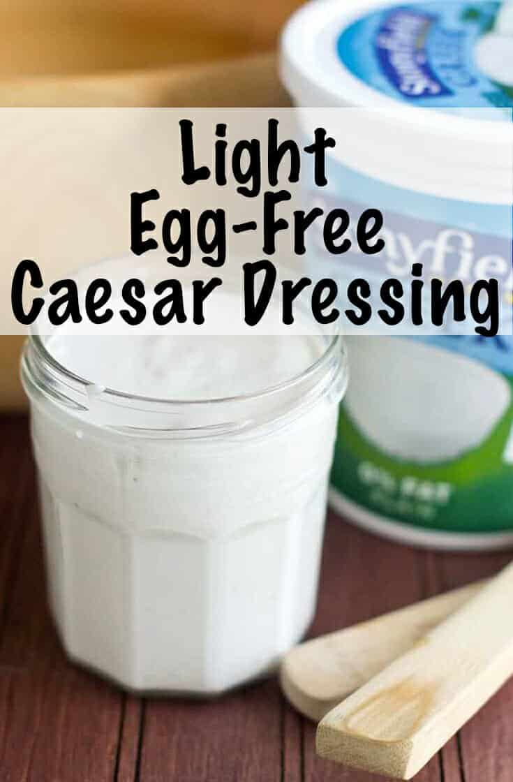 This easy, egg free caesar dressing is made with Greek yogurt and easily comes together in a blender. With just a little bit of oil it is a healthier alternative you\'ll love #healthyrecipes #caesar #dressing #greekyogurt