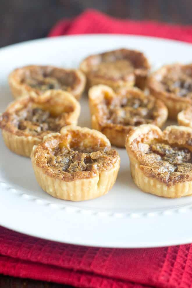 Butter Tarts are a quintessential Canadian treat that are a decadent, delicious and surprisingly easy addition to anyone's holiday dessert tray. They're so easy that I've made two batches already this year. Learn how to make this classic decadent tart.