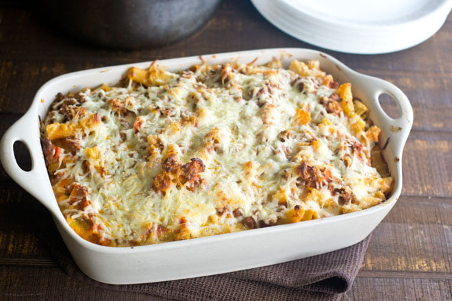 This baked ziti recipe is the real deal - it's the Italian-American classic that you know and love and crave, crave, CRAVE! And guess what? It's easy to make and feeds a crowd.