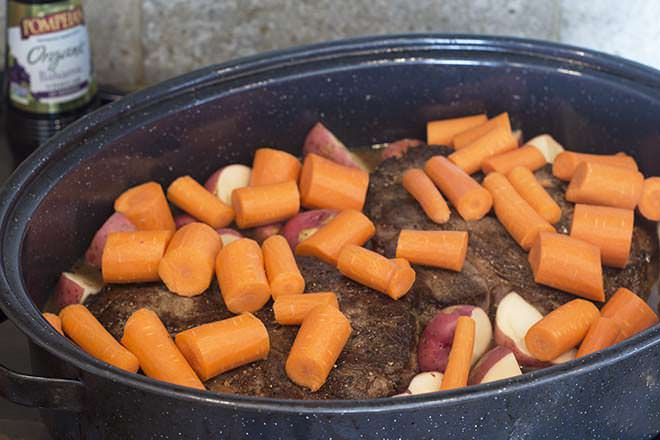 Top the roast with the carrots.