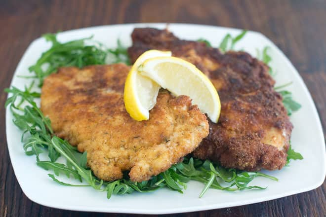 Learn how to make chicken cutlets. You start with chicken breasts that you pound flat. Then you move on to breading them, frying and then baking them until crisp. I've included lots of tips and tricks to make things less messy and easier as well. Enjoy!