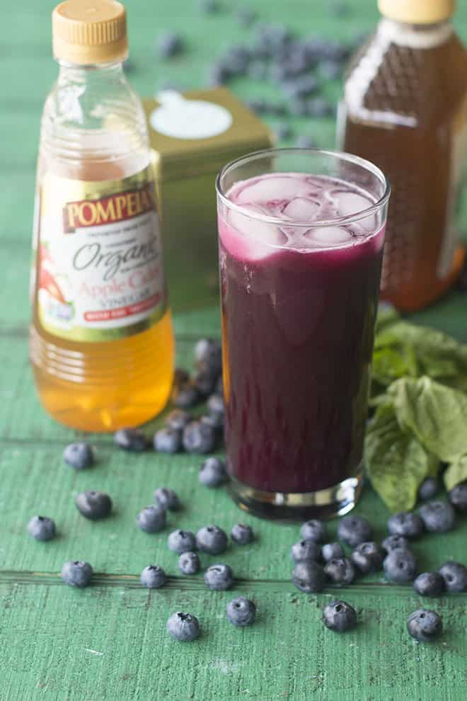 Adding apple cider vinegar to your diet? Try it in a delicious soda with blueberries and green tea.