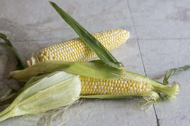 Shucking corn on the cob