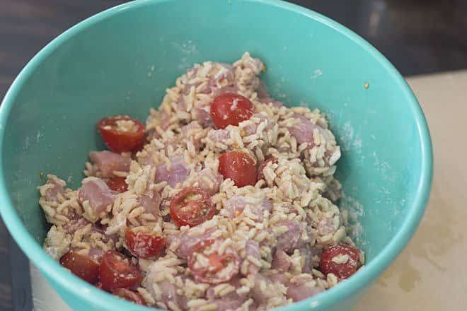 Chicken mixed with brown rice and tomatoes.