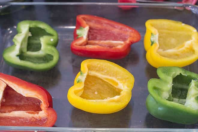 Bell pepper halves in a baking dish.