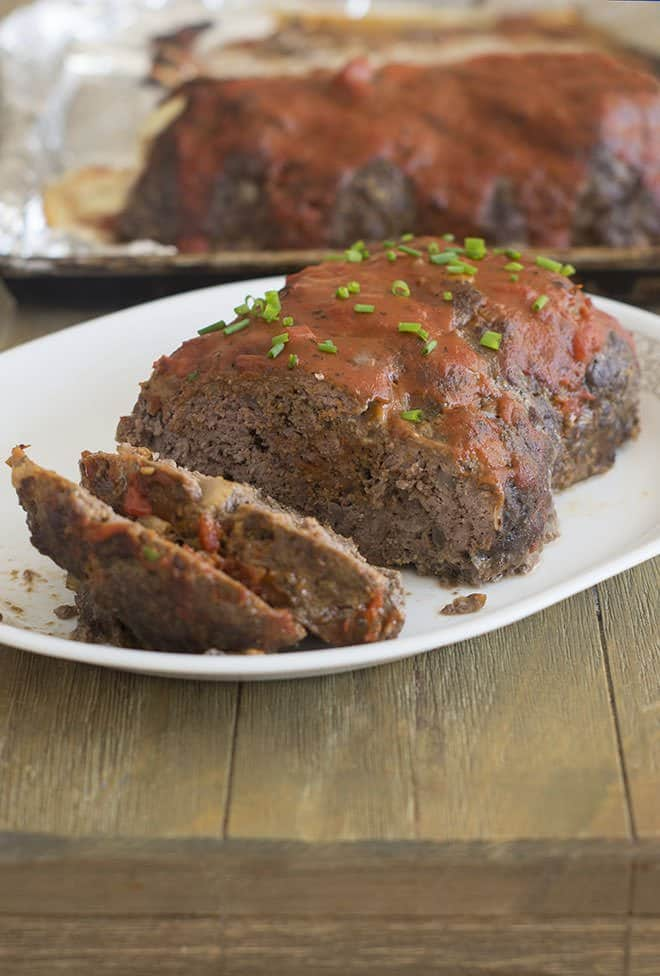 This meatloaf recipe is amazing - perfectly seasoned and guaranteed to slice easily. The tomato sauce glaze is delicious too!