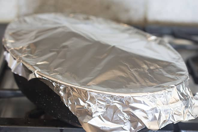 Roasting pan covered in aluminum foil